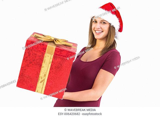 Pretty girl in santa hat holding gift box
