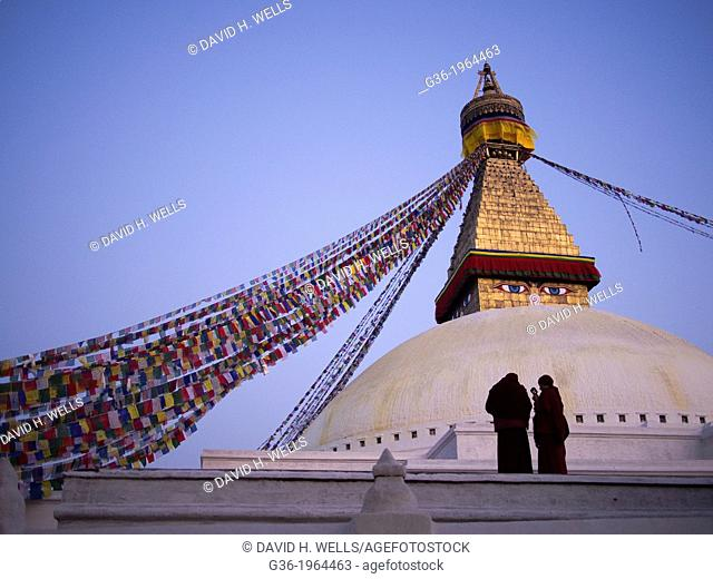 Flags hang from a Buddhist temple (Stupa) as people gather in Kathmandu, Nepal