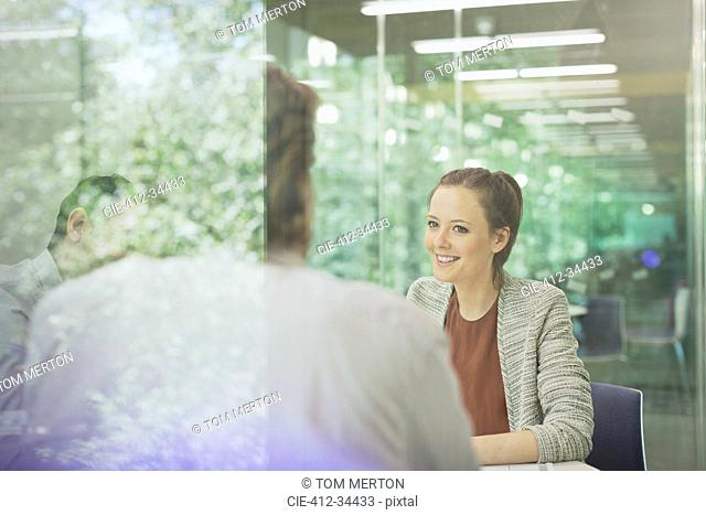 Businesswoman listening in conference room meeting