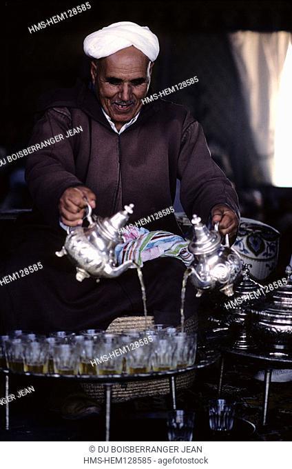 Morocco, a man serves the traditional tea