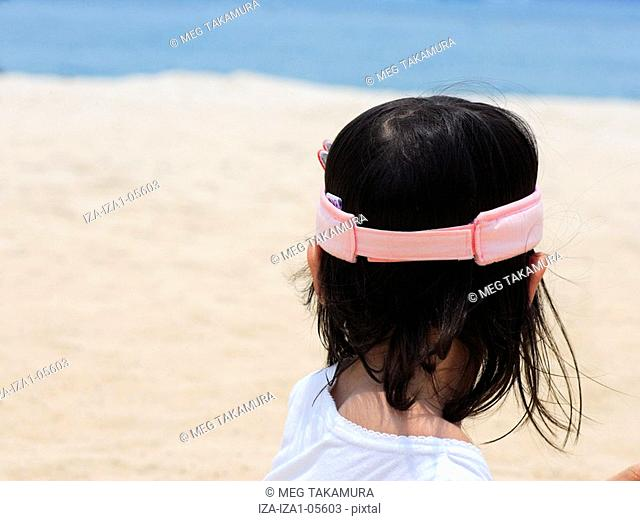 Rear view of a girl on the beach