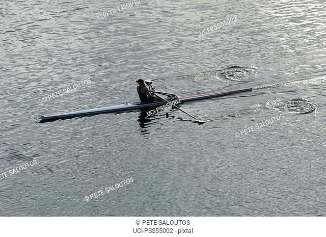 Woman rowing rowboat