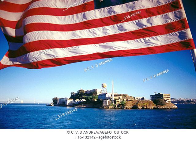 American flag and Alcatraz Island in background. San Francisco. California. USA