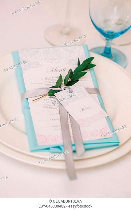 Decorated with bow menu on setting, served table