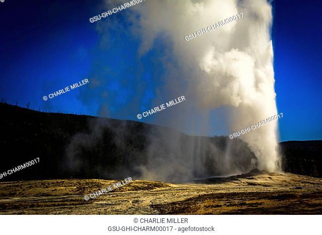 Old Faithful Erupting, Yellowstone National Park, Wyoming, USA