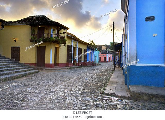 Cobbled street at dusk with brightly painted houses, off Plaza Mayor, Trinidad, Cuba, West Indies, Central America
