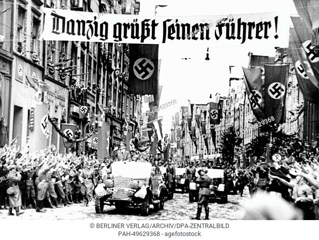 The Nazi propaganda picture shows Adolf Hitler arriving in the Free State of Danzig, 19 September 1939. The Nazi news report on the back of the picture reads:...