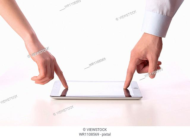 Businessmen pointing to tablet