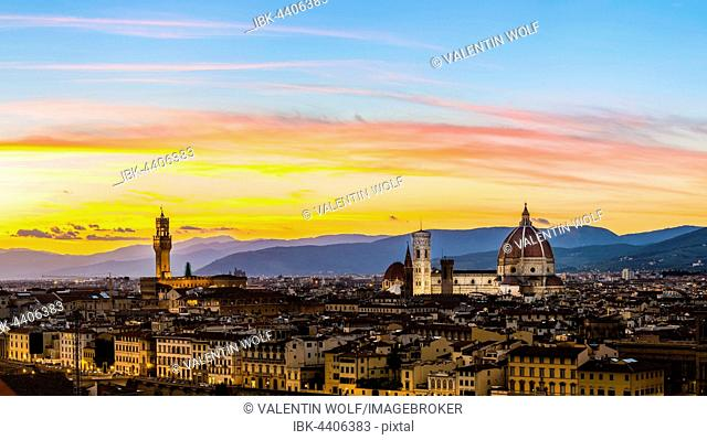 Panoramic view of city at sunset from Michelangelo Square, Piazzale Michelangelo, with Cathedral of Santa Maria del Fiore and Palazzo Vecchio, Florence, Tuscany
