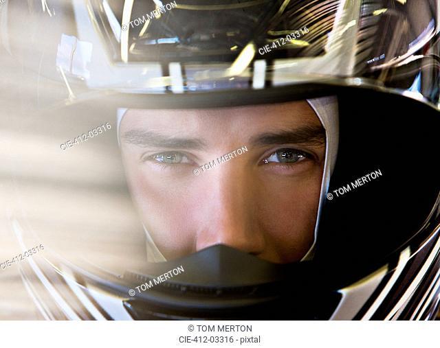 Close up of racer wearing helmet
