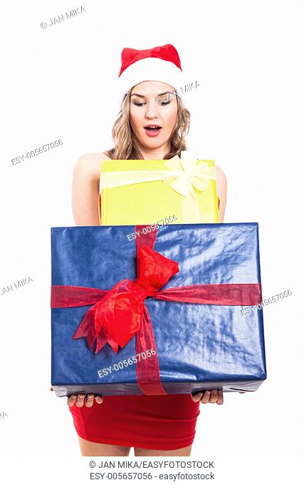 Surprised Christmas woman holding presents, isolated on white background