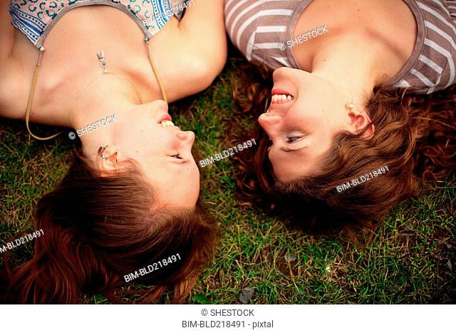 Close up of smiling girls laying in grass