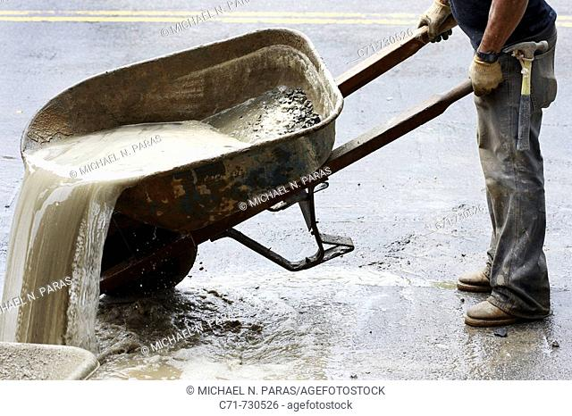 Construction pouring cement/concrete used water out of wheel barrow