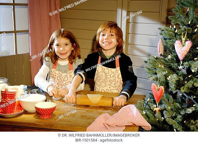 Christmas bakery, children baking cookies