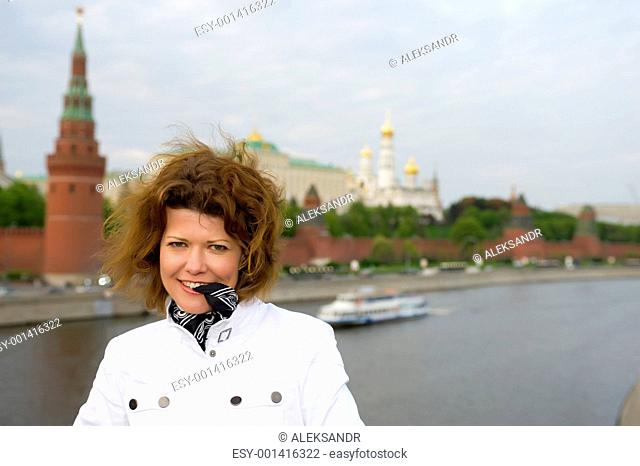 woman and Moscow kremlin close up