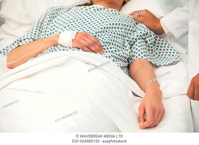 Old sick lady lying in hospital bed
