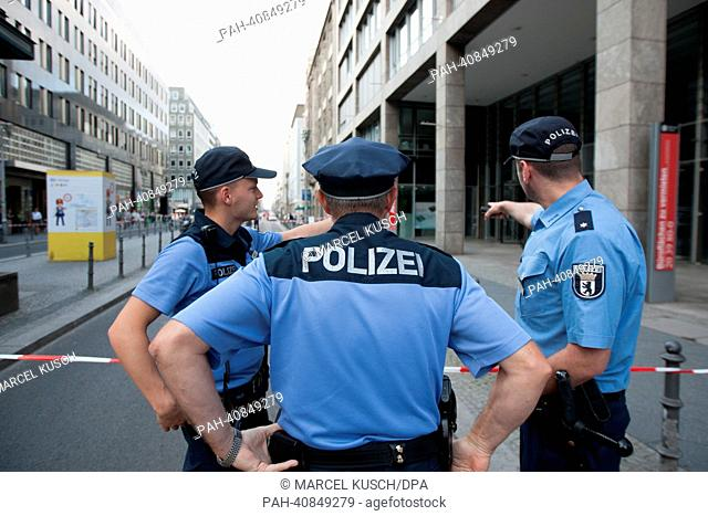 Police officers stand on the closed Friedrichstraße in Berlin, Germany, 05 July 2013. The police closed parts of the street after an unclaimed suitcase had been...