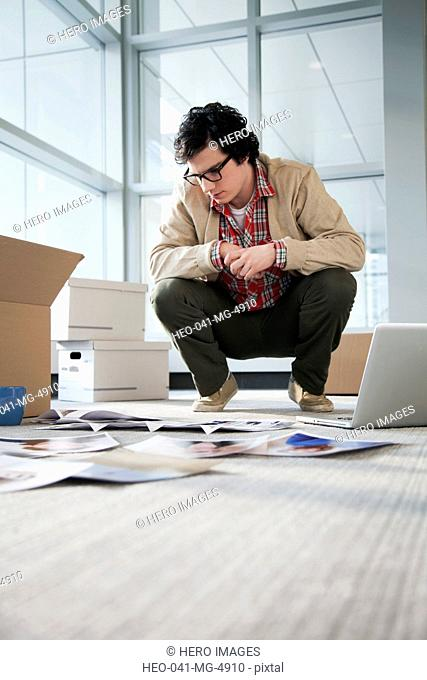 young businessman unpacking office