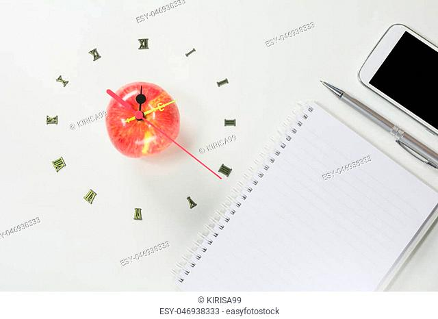 The apple with number of clock and smart phone, apple shape clock on white background