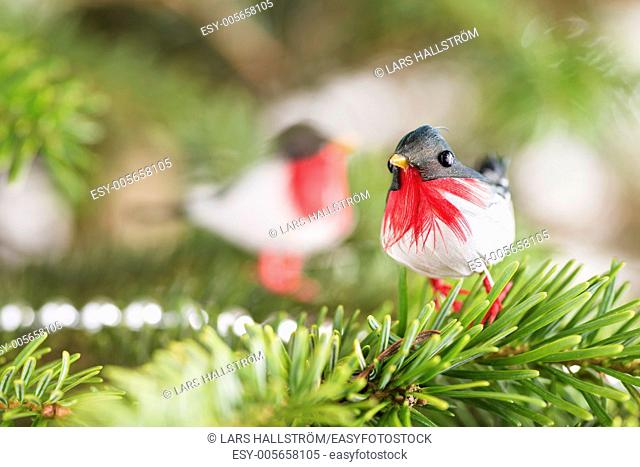 Closeup of decorative birds in christmas tree