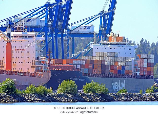 Ships at container terminal on Fraser River, Surrey, British Columbia