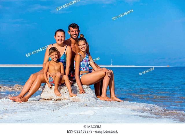 Beautiful family at the spa Dead Sea. Israel
