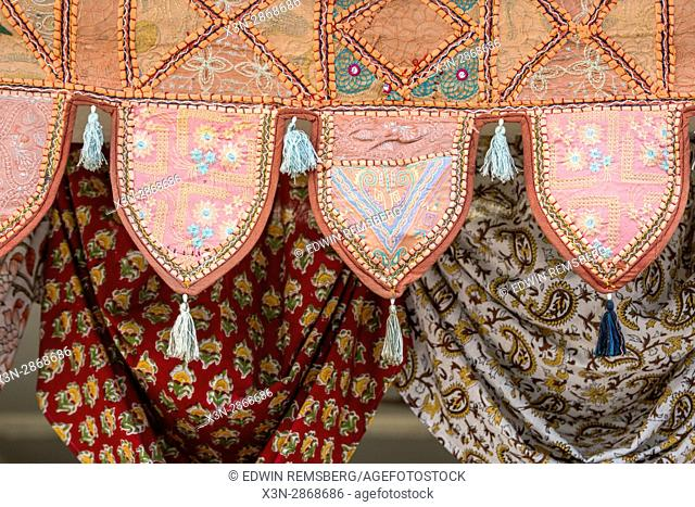 Jaipur, India - oriental rugs hung in a storefront