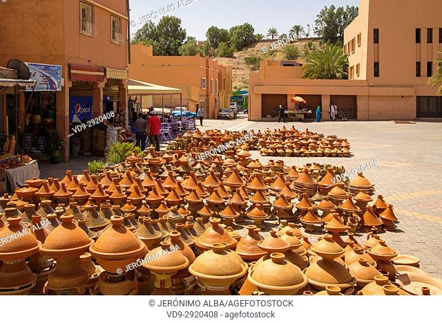 Tajine, traditional clay pot using to prepare vegetables with meat. Ouarzazate market. Morocco, Maghreb North Africa