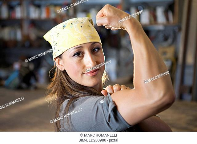 Hispanic worker flexing biceps