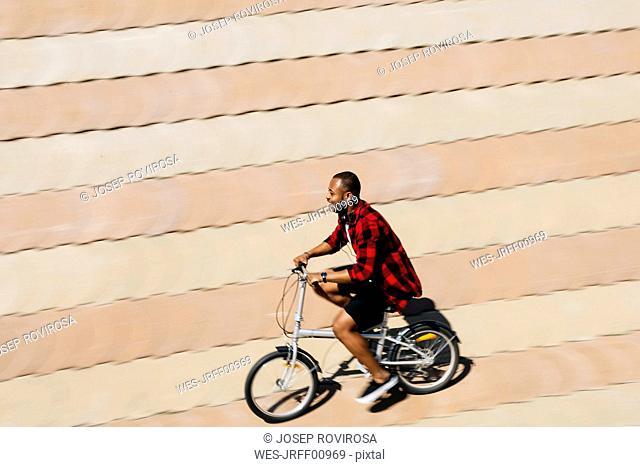 Smiling man riding bicycle