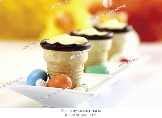 Waffle cups with cream in a row