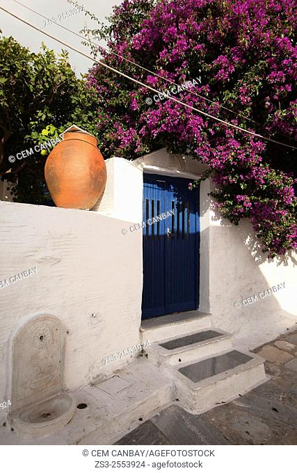 Whitewashed house with blue door in Pyrgos village, Tinos Island, Cyclades Islands, Greek Islands, Greece, Europe