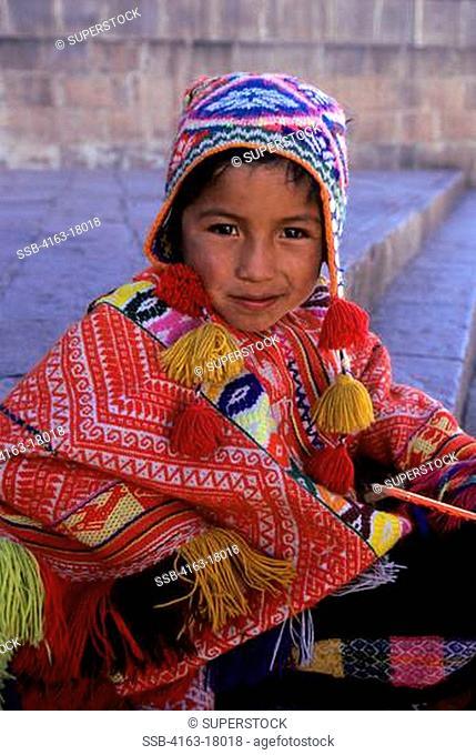 PERU, CUZCO, LOCAL BOY IN TRADITIONAL CLOTHING QUECHUA, PORTRAIT