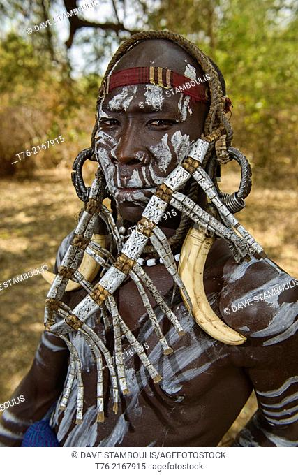 Mursi guy with watch band jewelery in the Lower Omo Valley of Ethiopia