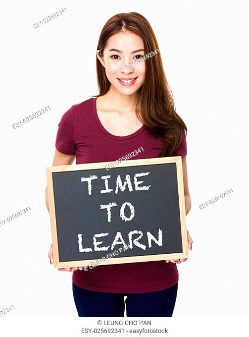 Young woman show with chalkboard phrase time to learn