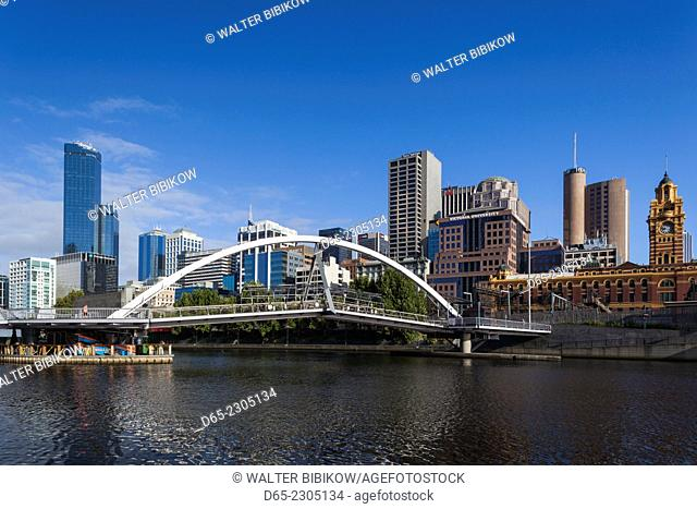 Australia, Victoria, VIC, Melbourne, skyline from Yarra River with footbridge