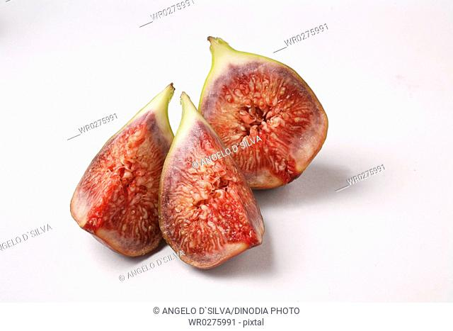 Fruit , Figs Ficus Carica Anjir cut in three pieces red juicy texture on white background
