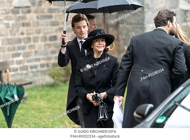 Queen Silvia of Sweden walks towards the church where the funeral service for Prince Richard of Sayn-Wittgenstein-Berleburg will take place in Bad Berleburg