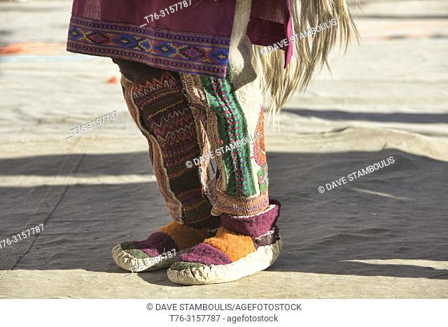 The feet of an Aryan (Brogpa) dancer at a festival, Biama village, Ladakh, India