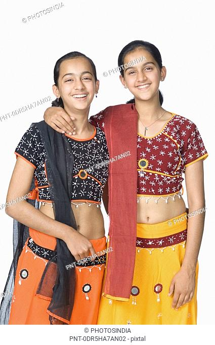 Portrait of a teenage girl standing with her sister