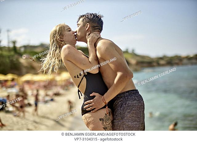 Greece, Crete, Chersonissos, couple in swimwear at beach, passionate, kissing, love, relationship, holiday, flirt