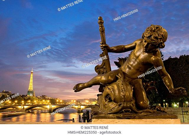 France, Paris, banks of the Seine River listed as World Heritage by UNESCO, Pont Alexandre III and Eiffel Tower in the background