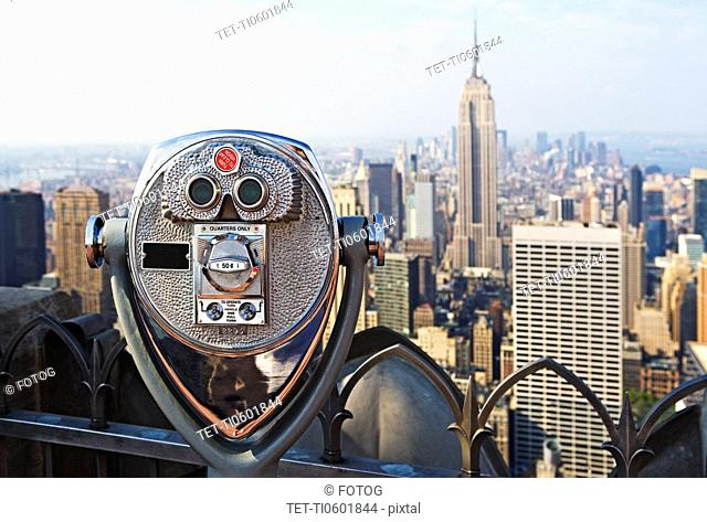 USA, New York State, New York City, Coin-operated binoculars on top of skyscraper
