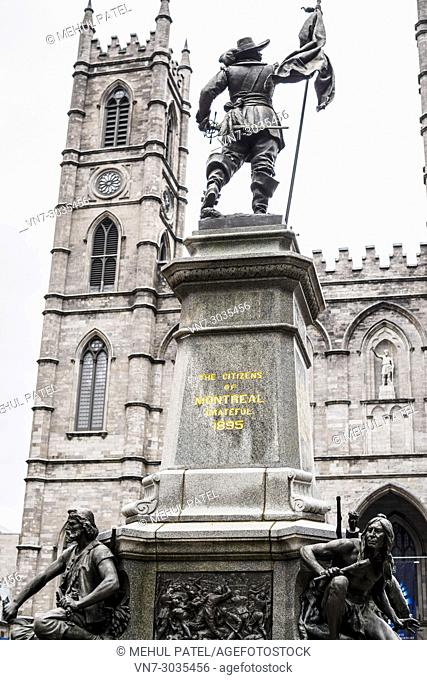 Maisonneuve Monument in front of the Notre Dame Basilica Montreal on Place d'Armes, Montreal, Canada. The Maisonneuve Monument is a monument by sculptor...