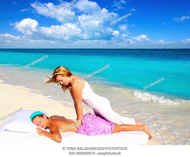 Caribbean beach massage shiatsu waist pressure woman outdoor paradise