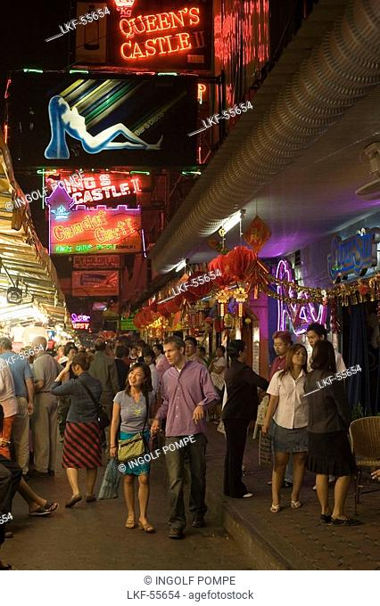People walking over a night market along bars and clubs, Patpong, red light and entertainment district, Bang Rak district, Bangkok, Thailand
