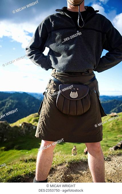 A Man Wearing A Skirt And Pouch Around His Waist, Whanganui National Park; Whakahoro, New Zealand