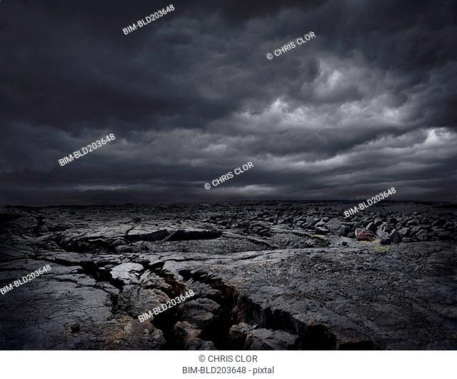 Storm clouds over dry rocky landscape