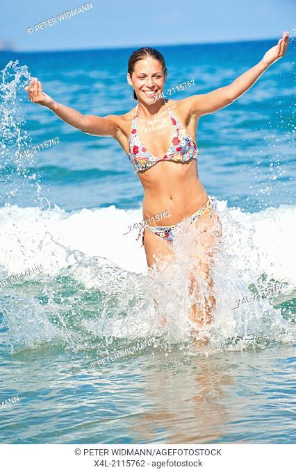young, pretty, sportive woman in bikini in the water (model-released)