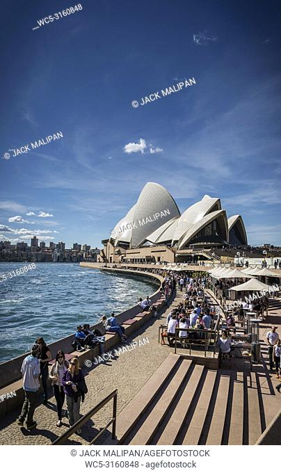 sydney opera house and harbour promenade outdoor cafes in australia on sunny day